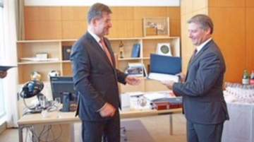 Lajčák presented Korneliou a certificate of achievement in recognition of his contribution