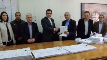 Constantinos Yiorkadjis, mayor, Nicosia, (L) and Stavros Theodosiou, CEO, A.Panayides Contracting with other municipality and company staff